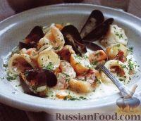 Фото к рецепту: Картофель, тушенный с морепродуктами