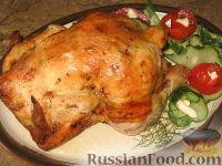 Фото к рецепту: Курица на бутылке