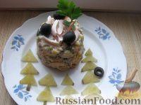 Фото к рецепту: Оливье с кальмарами