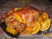 Фото к рецепту: Курица, запечённая с апельсинами и тыквой