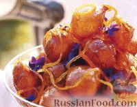 Фото к рецепту: Пончики с цитрусовым сиропом
