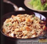 Фото к рецепту: Ризотто с курицей и грибами