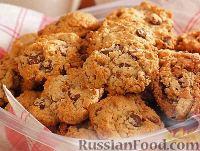 Фото к рецепту: Овсяное печенье с шоколадом и орехами