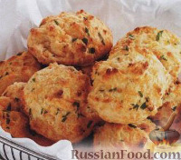 Фото к рецепту: Сырные шарики с чесноком и петрушкой