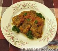 Фото к рецепту: Хек тушеный с помидорами и зеленью