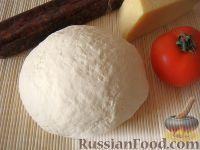 Фото к рецепту: Бездрожжевое тесто для пиццы