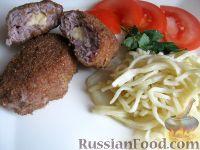 Фото к рецепту: Котлеты из индейки с сыром