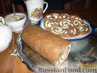 Фото к рецепту: Рулет из печенья с зефиром