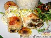 Фото к рецепту: Куриные рулеты с черносливом и печенью