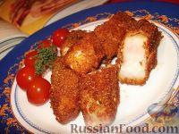 Фото к рецепту: Рыбные палочки в папрично-сырной панировке