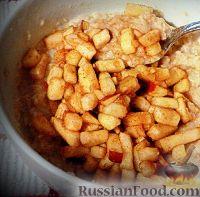Фото к рецепту: Печеные яблоки с орехами и изюмом