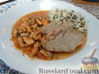 Фото к рецепту: Свиное филе, тушенное с мидиями