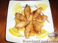Фото к рецепту: Кальмары фаршированные