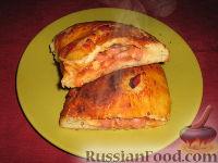 Фото к рецепту: Кальцоне с моцареллой и сосисками