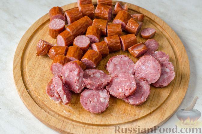 Фото приготовления рецепта: Тыквенная похлебка с чечевицей, фрикадельками и копчёными колбасками - шаг №10
