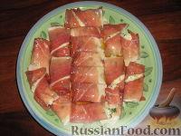 Фото к рецепту: Рулетики из сырокопченой ветчины фаршированные