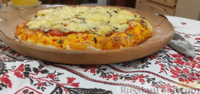 Фото приготовления рецепта: Киш с капустой и черносливом, в яично-сметанной заливке с сыром - шаг №3