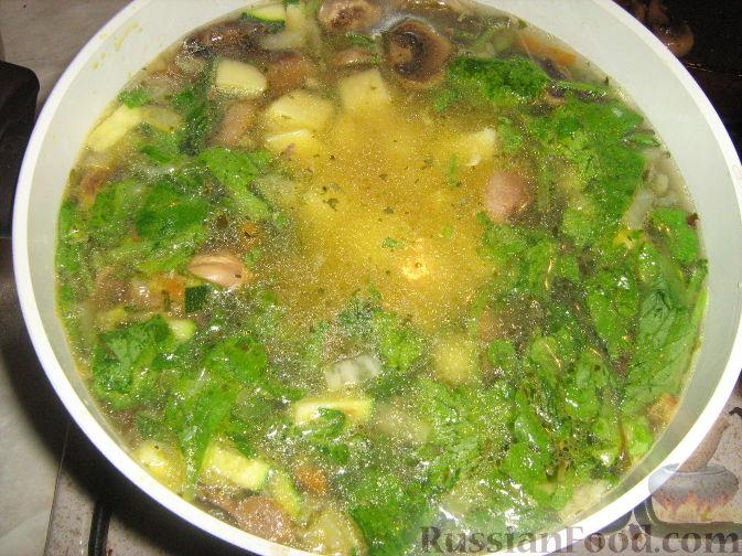 Фото приготовления рецепта: Куриные тефтели, запечённые с гречкой - шаг №8