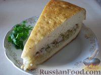Фото к рецепту: Пирог из сырой рыбы с луком и рисом