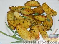 Фото к рецепту: Румяные картофельные дольки на гарнир