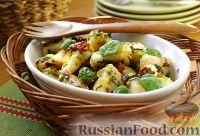 Фото к рецепту: Картофельные ньокки (gnocchi di patate) с луком-пореем и вялеными помидорами