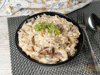 Фото к рецепту: Куриные сердечки в сырном соусе