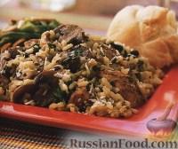Фото к рецепту: Курица с рисом, грибами и пармезаном