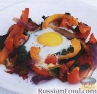 Фото к рецепту: Яйца, запеченные с помидорами и перцем