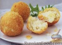Фото к рецепту: Рисовые шарики с сыром