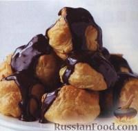 Фото к рецепту: Шоколадно-апельсиновые профитроли