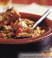 Фото к рецепту: Арроз кон Пойо (Arroz con Pollo)