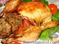 Фото к рецепту: Запеченная курица с пикантной ореховой начинкой