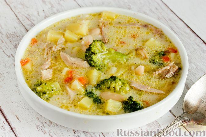 Фото приготовления рецепта: Рисовый суп с капустой и сыром - шаг №5