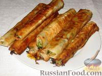 Фото к рецепту: Молдавские вертуты с капустой, из лаваша