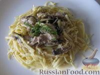 Фото к рецепту: Паста с курицей и грибами под сливочным соусом