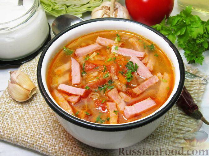 Фото к рецепту: Суп с капустой, помидорами, рисом и ветчиной
