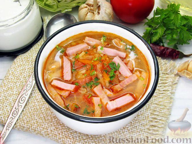 Фото приготовления рецепта: Суп с капустой, помидорами, рисом и ветчиной - шаг №16