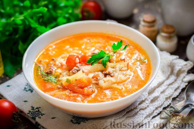 Фото приготовления рецепта: Суп с фаршем, капустой и рисом - шаг №12