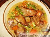 Фото к рецепту: Телятина, тушенная с морковью и горошком