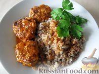 Фото к рецепту: Тефтели с рисом  в томатном соусе