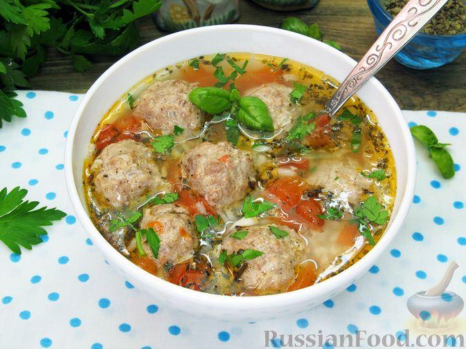 Фото приготовления рецепта: Суп с рисом и фрикадельками - шаг №16