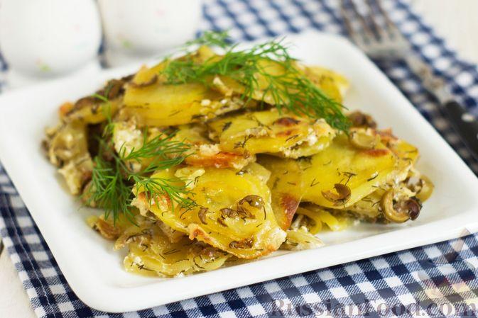Фото к рецепту: Картофельная запеканка с оливками, розмарином и чесноком