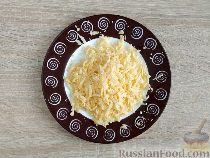 Фото приготовления рецепта: Запеканка из кабачка с мясными фрикадельками - шаг №14