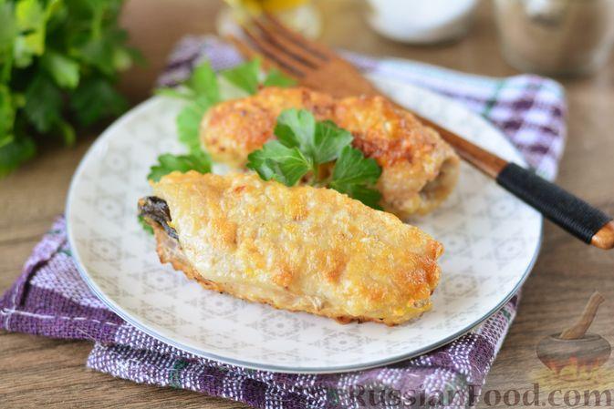 Фото к рецепту: Свиные рулетики с черносливом и грецкими орехами