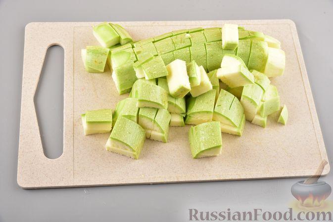 Фото приготовления рецепта: Хек, запечённый с кабачком и морковью (в рукаве) - шаг №2