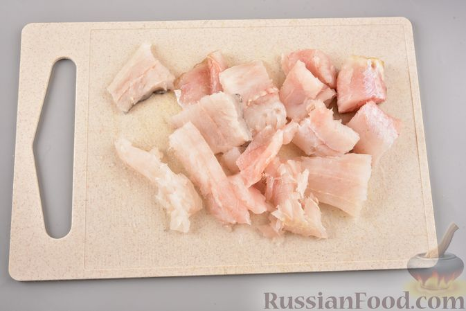 Фото приготовления рецепта: Хек, запечённый с кабачком и морковью (в рукаве) - шаг №5