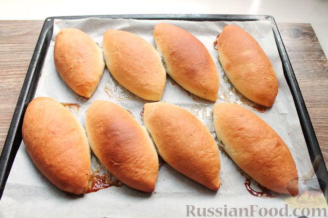 Фото приготовления рецепта: Дрожжевые пирожки со щавелем - шаг №27