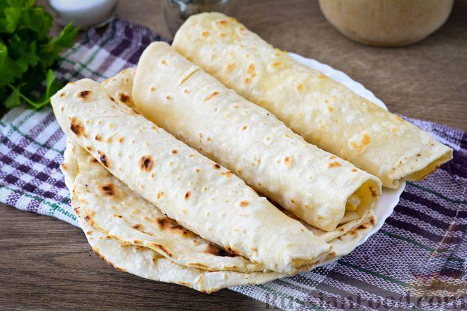 Фото приготовления рецепта: Лаваш из заварного теста, с яичной начинкой (на сковороде) - шаг №13