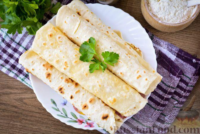 Фото приготовления рецепта: Лаваш из заварного теста, с яичной начинкой (на сковороде) - шаг №14