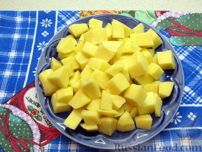 Фото приготовления рецепта: Куриный суп с овсяными хлопьями - шаг №7